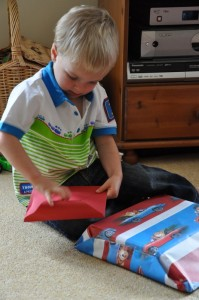 Marcus opening a card on his 2nd birthday