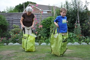 Grandma and Daniel in a sack race