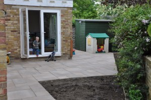 Marcus stepping out onto the new patio